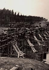 Gulag prisoners constructing a railway bridge over the river Izhma in northern Russia, 1940